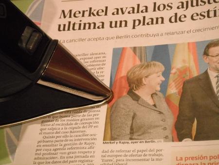 Merkel e o ferro de pasar